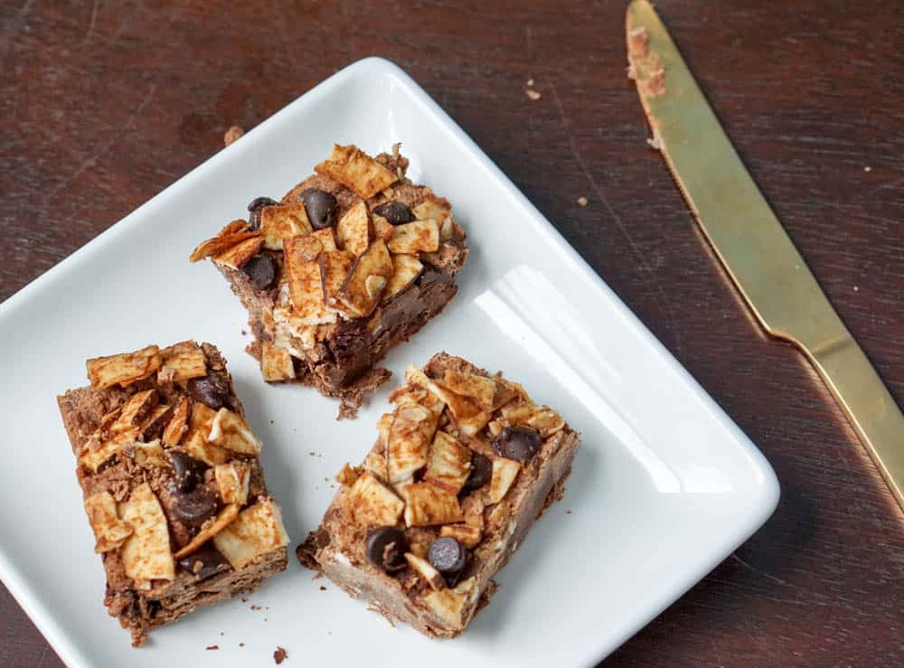 Chocolate Masala Fudge squares take cinnamon, cardamom fudge to the next level. Packed with ginger, dates, and coconut - this decadent treat is healthy!