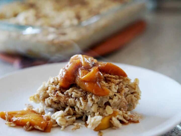 This easy egg alternative will save time in the mornings. Gluten free, dairy free, refined sugar free, paleo and vegan healthy baked oatmeal made with peaches and rhubarb recipe with just enough cinnamon and nutmeg.