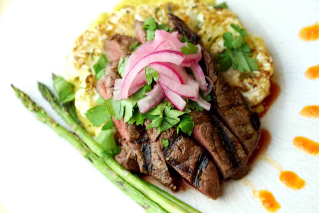 The Deconstructed Steak Taco on Curried Cauliflower Steak recipe merges the flavors of street tacos with Asian cuisine and the traditional steak house: Latin fusion that's healthy, gluten free, grain free and dairy free.