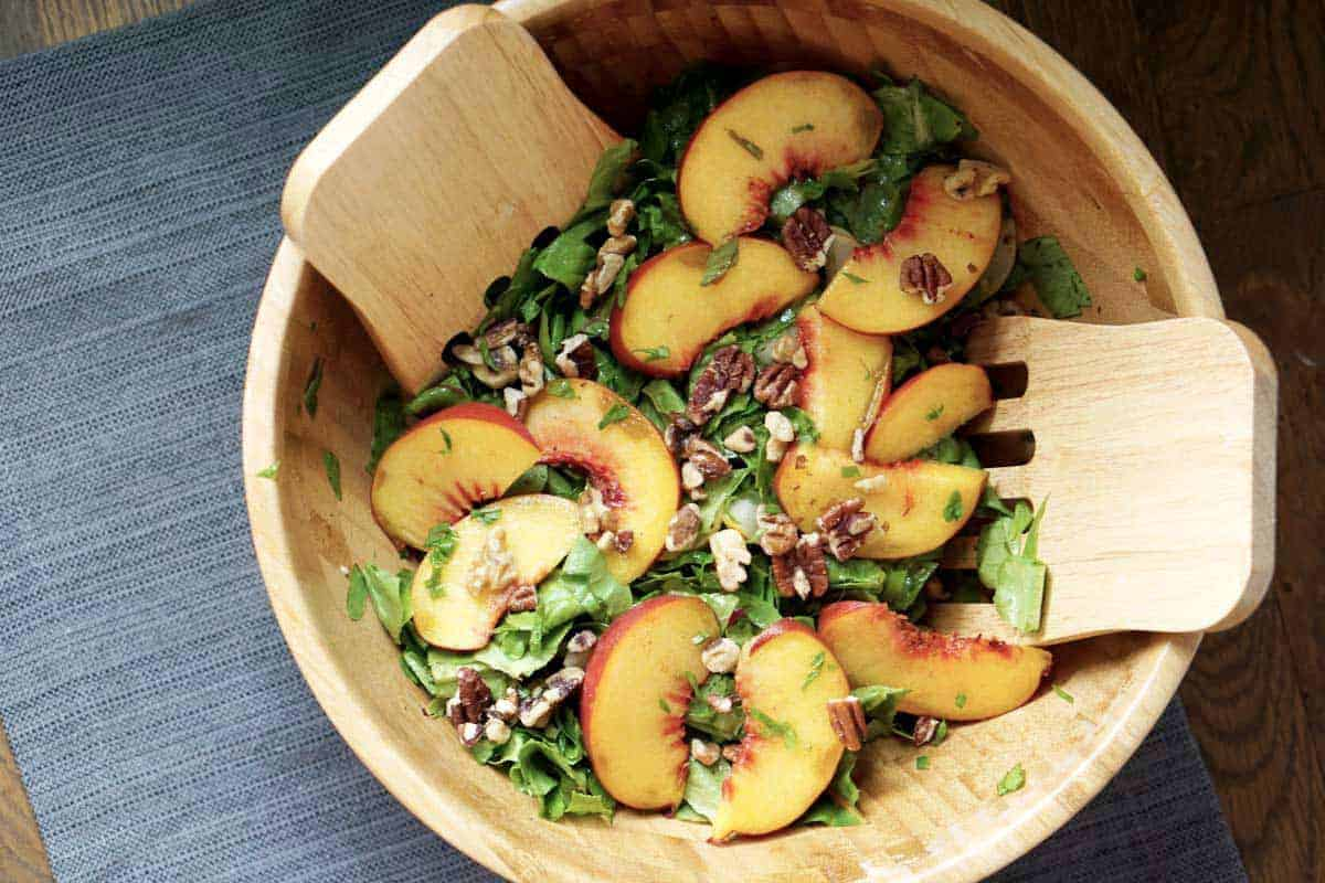This toasted pecan, cucumber, basil, and peach salad is super fresh and incorporates summer and fall flavors into one great gluten and dairy free dish. It's also super quick and sugar-free