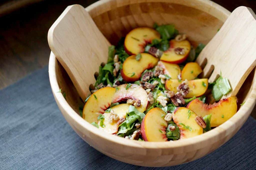 Fresh tossed peach, pecan, basil cucumber salad merges summer and fall flavors - gluten, dairy, sugar, soy, corn free