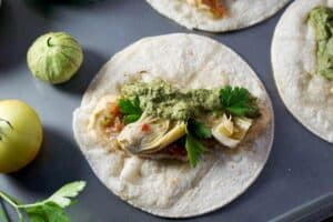quick and easy tacos, made with hummus, salsa, and marinated artichoke hearts. Quick and easy meatless monday meal