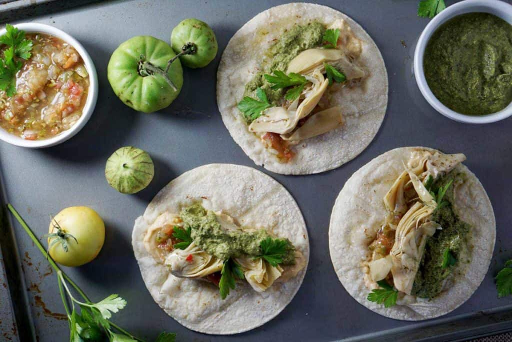 These quick vegan artichoke hummus tacos with carrot top pesto are natrually gluten, dairy, nut, refined sugar and soy free