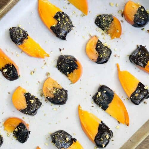 Dip ripe Hachiya or Fuyu persimmons in homemade chocolate sauce and top with crushed pistachios for the easiest dessert to impress.