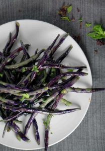 Blistered Purple Hyacinth green beans sauteed with white truffle paste create a purple and green tie-dyed plate that's the perfect savory accompaniment for any dinner.