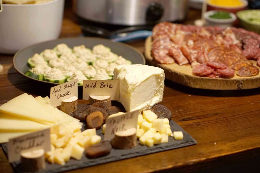 charcuterie, Indoor S'Mores, Chili Bar, Meatballs, Hummus Cukes, Champagne punch and more! Find a healthy and comforting menu for your lumberjack New Years Eve Party