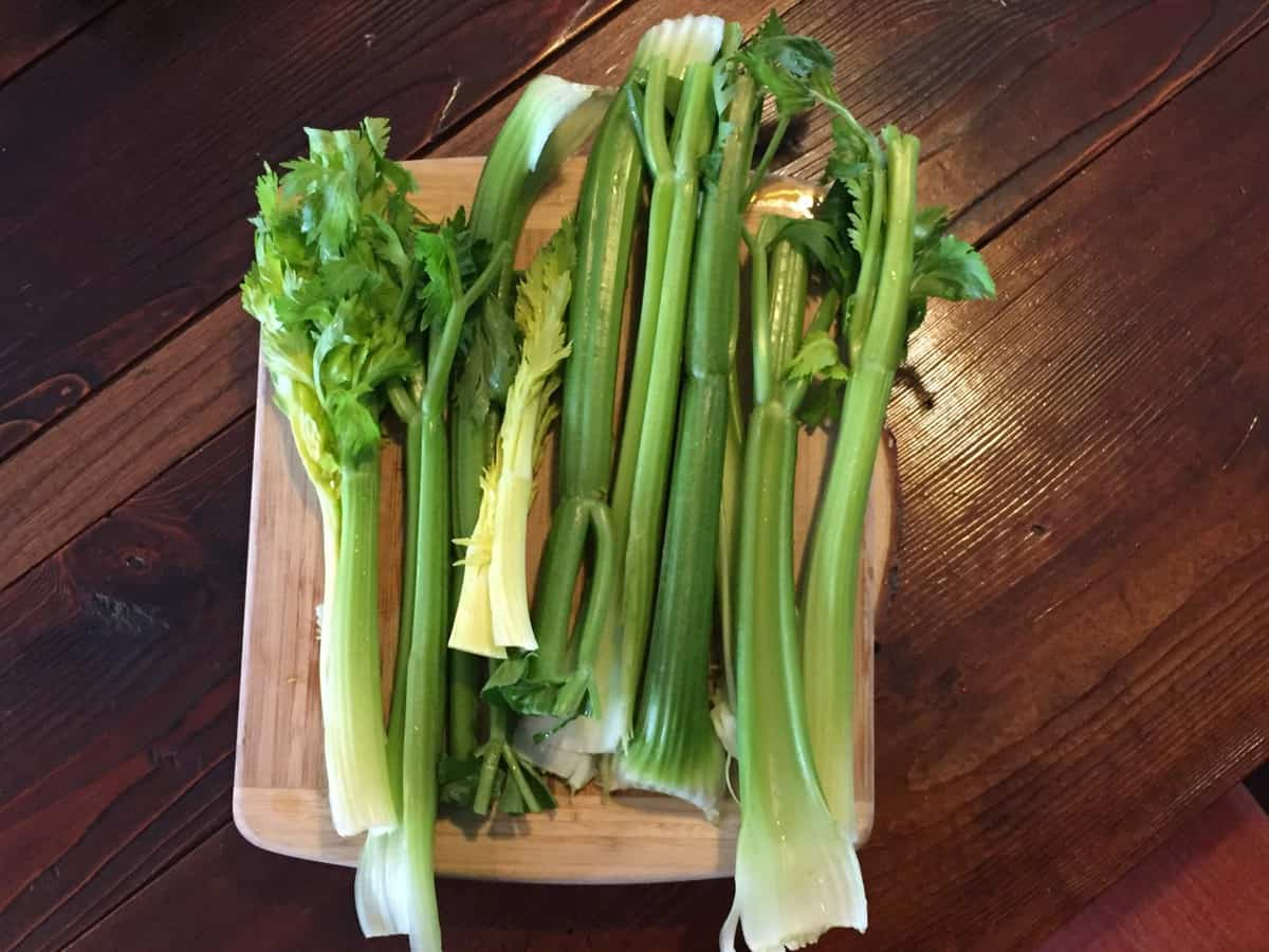 celery stalks on a cuting board waiting to be made into juice. Full of mineral salts good for healing the gut