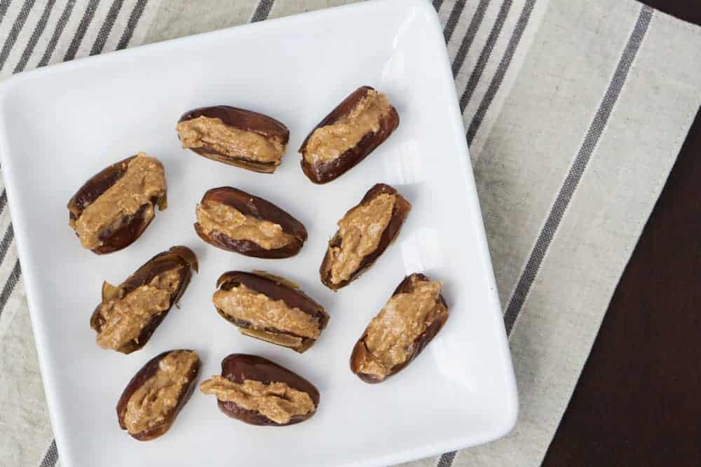 Almond coconut date bombs are a simple fat bomb that's high protein, high fat, and low carb. Great for the 3 pmslump to keep you nourished, balance blood sugars and regulate your hunger signals.