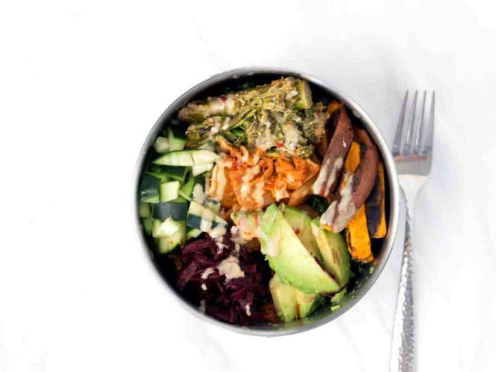 Loaded Kale Salad Bowl Recipe with Sweet potatoes, cucumbers, beets, Kimchi, tahini brocolini, avocado on tahini massaged Kale