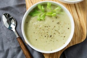 Paleo cream of celery soup recipe without the cream? This refreshing gluten free, dairy free soup uses cauliflower and healthy oils instead.