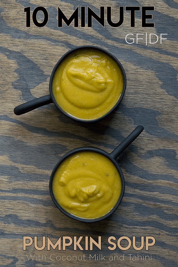 Simple blended 10 minute pumpkin soup with coconut milk and tahini in a black mug. GLuten free, dairy free, whole 30, paleo, and keto