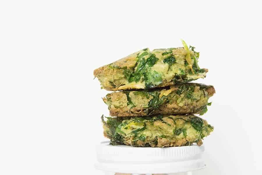 3 stacked Celery Pulp Fritters on white background