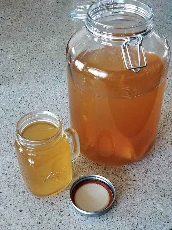 Home brewed Jun, a honey and green tea version of kombucha, brew and glass