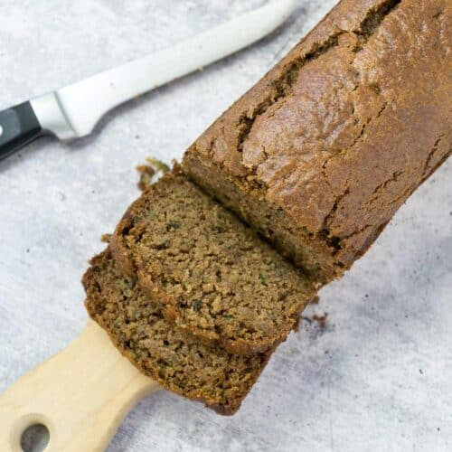 sliced gluten free zucchini bread with knife