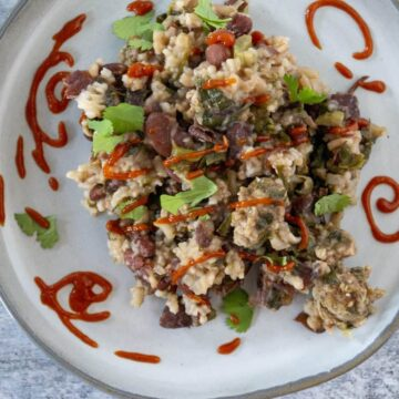 Red beans and Rice with Greens and sriracha swirls