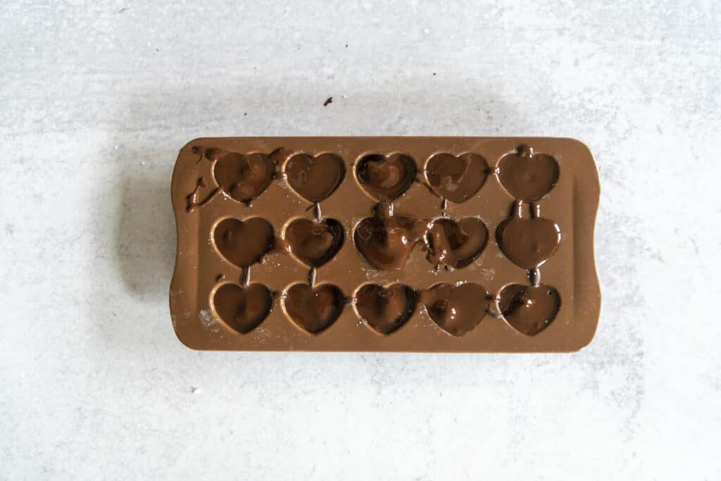 Chocolate Coconut Butter Cups in molds