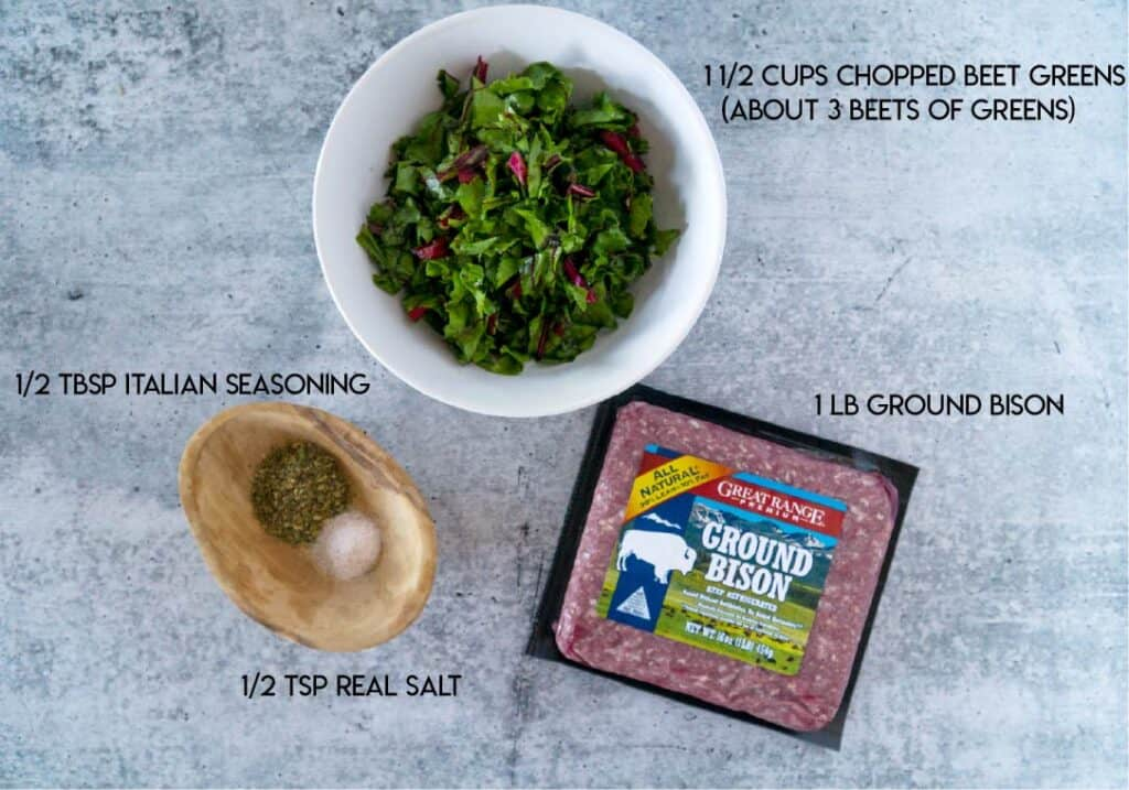 Meatball ingredients: bowl of beet greens, another bowl of italian seasoning and salt, package of ground bison