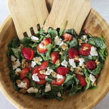 Strawberry Spinach Salad in wooden salad bowl
