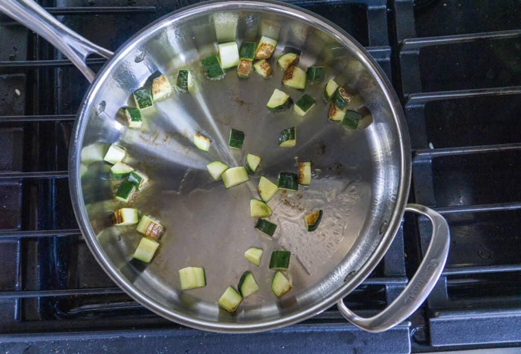 Sauteing zucchini until golden brown