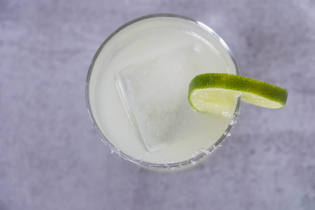 Overhead view of Lime wedge in salted margarita glass