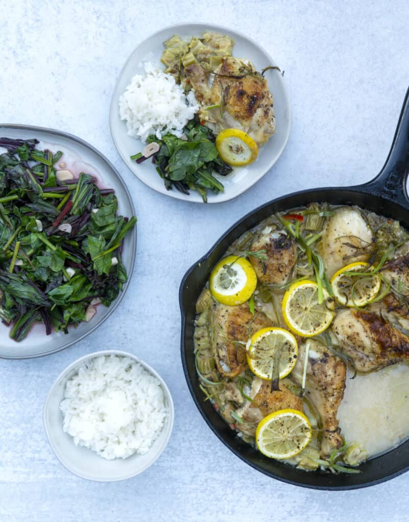 Skillet of Rhubarb Chicken and plates of garlic wilted beets and white rice