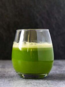 Foamy celery juice in a glass