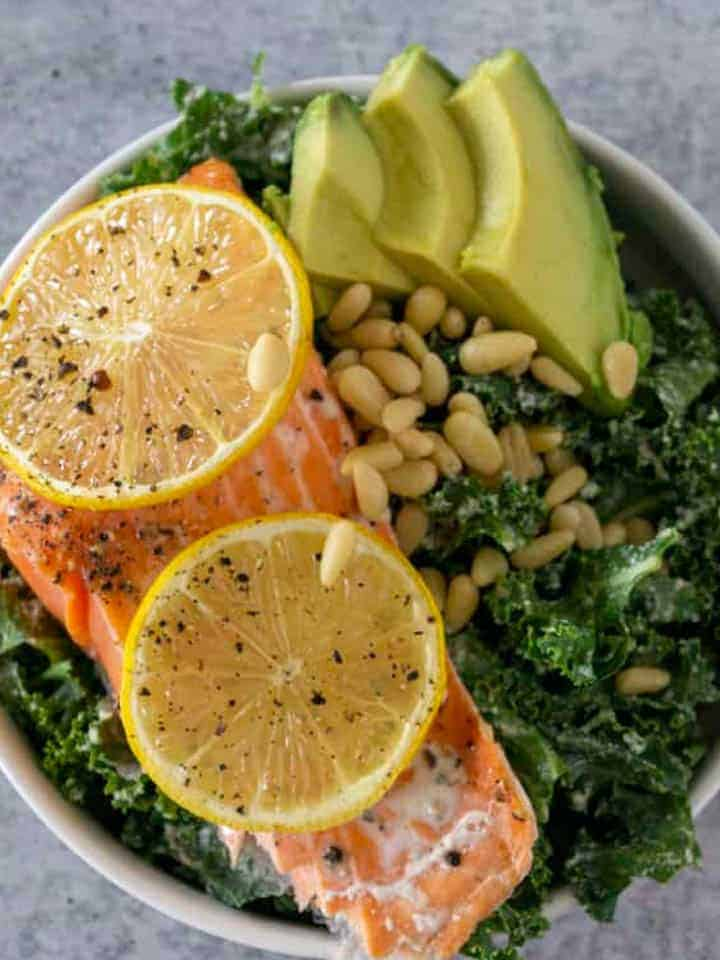Avocado, Pine Nuts, and Lemon Baked Salmon on Kale Salad