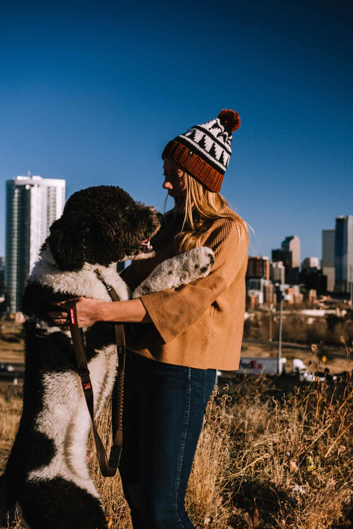 Blond girl with bernadoodle dog