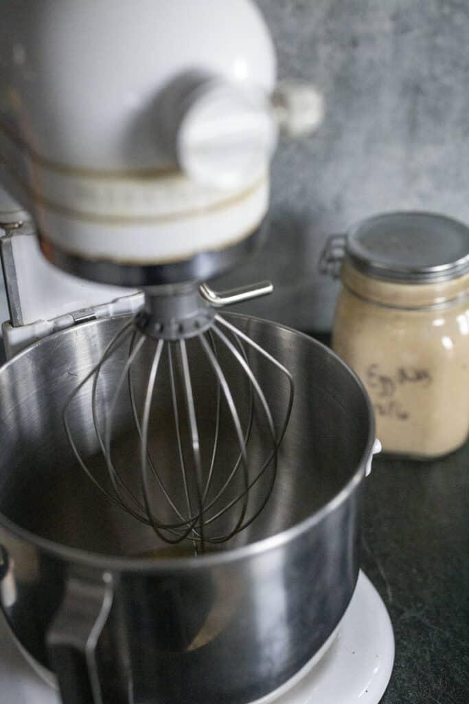 Kitchen aid mixer for egg whites, eggnog in background